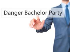 Danger Bachelor Party - Businessman hand pressing button on touch screen inte Stock Photos