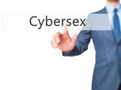 Cybersex - Businessman hand pressing button on touch screen interface. Stock Photos