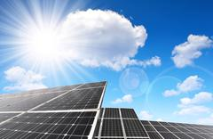 Solar panels against sunny sky. - stock photo