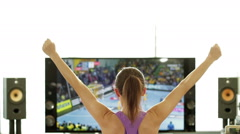 Young woman celebrating score points in handball, rear view HD Stock Footage