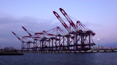 Jack hammers or giant cranes at LA harbor at dusk. Stock Footage