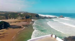 Zambujeira do Mar beach, Alentejo, Portugal aerial view Stock Footage