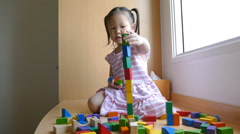 Girl playing with wood blocks Stock Footage