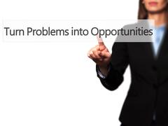 Turn Problems into Opportunities - Businesswoman hand pressing button on touc Stock Photos