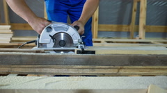 Cutting wooden floor by electric saw - stock footage