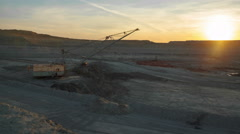 Timelapse. Dragline excavator load ore into dump-track. Sunset. Stock Footage