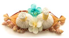 Pouches, decorative flowers orchid, shells, a basket - stock photo