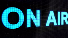 "Running line with text light-blue color "" ON AIR "" on the black screen. Stock Footage"