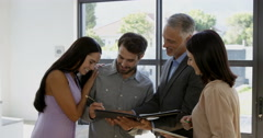 Couple signing the agreement to get their new house Stock Footage