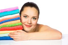 Portrait of beautiful spa girl with colorful towels - stock photo