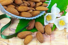 Almonds in crystal bowl - stock photo
