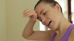 Portrait of tired brunette having rest in short break after workout HD Stock Footage