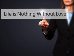 Life is Nothings Without Love - Businesswoman hand pressing button on touch s Stock Photos