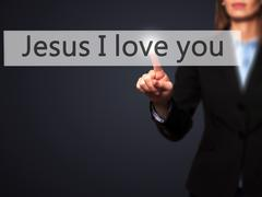 Jesus I love you - Businesswoman hand pressing button on touch screen interfa Stock Photos