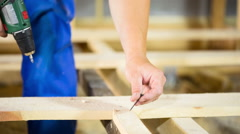 Worker use a screwdriver in the manufacture of wood products Stock Footage