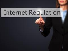 Internet Regulation - Businesswoman hand pressing button on touch screen inte Stock Photos