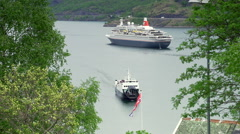 Small port with a large passenger ship Stock Footage