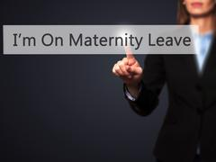 I'm On Maternity Leave - Businesswoman hand pressing button on touch screen i Stock Photos