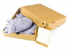 Clothes in open carton Stock Photos