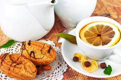 Cup of tea and cakes - stock photo