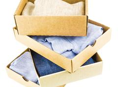 Stack of cartons with clothes - stock photo