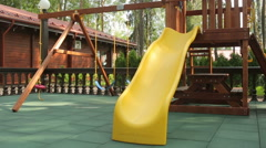Amazing playground swing outside the house Stock Footage