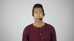 Serious Call Center Operator Talking to Customer Stock Footage