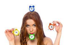 Woman with alarm clocks - stock photo