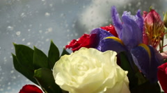 Beautiful bouquet roses, iris and alstroemeria rotates Stock Footage