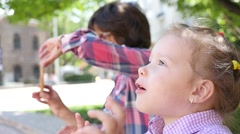 Bright emotions of little child kid girl first time seeing a beautiful thing  Stock Footage