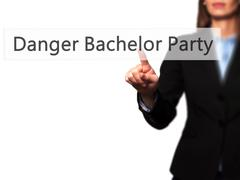 Danger Bachelor Party - Businesswoman hand pressing button on touch screen in Stock Photos