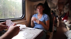 Man And Woman Plaing Cards In Train Stock Footage