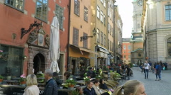 Pan from building to cafes in Stortorget, Gamla Stan, Stockholm Stock Footage