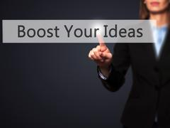 Boost Your Ideas - Businesswoman hand pressing button on touch screen interfa Stock Photos
