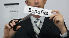 Businessman Cuts Benefits Concept - stock photo