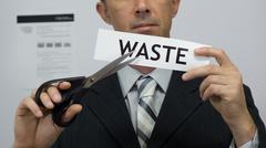 Businessman Cuts Waste Concept - stock photo