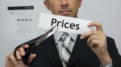 Businessman Cuts Prices Concept - stock photo