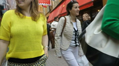 Tourist with yellow pullover top in Gamla Stan, Stockholm SloMo Stock Footage