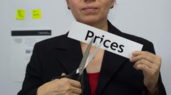 Businesswoman Cuts Prices Concept - stock photo