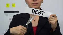 Businesswoman Cuts Debt Concept - stock photo