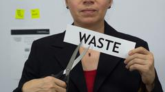Businesswoman Cuts Waste Concept - stock photo
