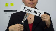 Businesswoman Cuts Spending Concept - stock photo