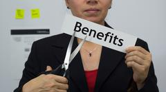Businesswoman Cuts Benefits Concept - stock photo