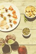 Appetizers on a summer day with wine - stock photo