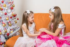 Two girls in beautiful dresses waiting Gift joined hands Kuvituskuvat
