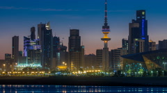 Seaside skyline of Kuwait city from night to day timelapse Stock Footage