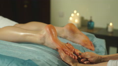 A woman doing a foot massage Stock Footage