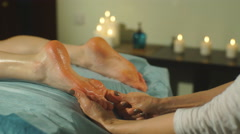 a woman doing a foot massage - stock footage