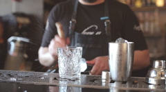 Bartender mannually crushed ice with wooden metal knife - stock footage