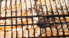 juicy meat is fried in a lattice on fire - stock footage